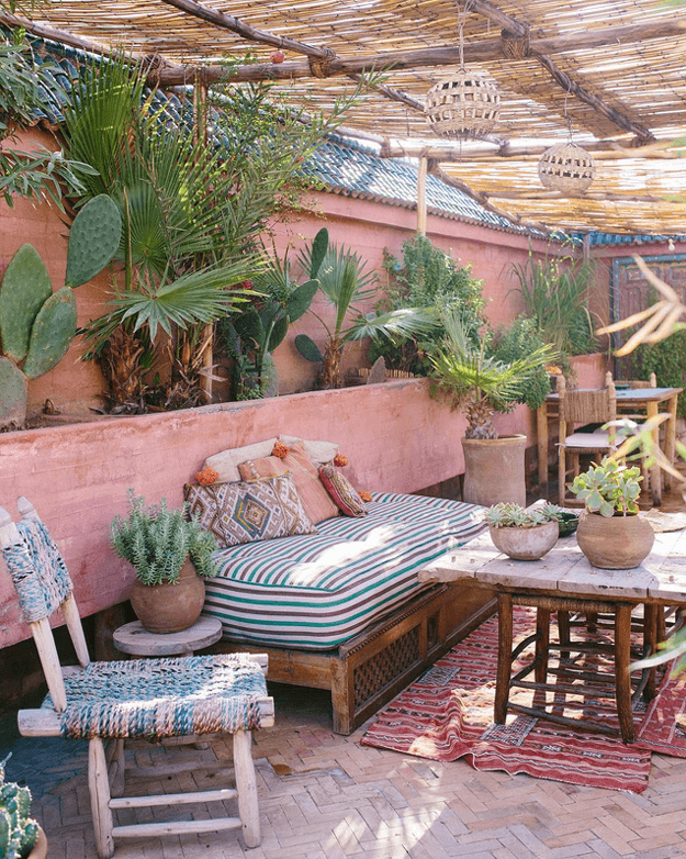 bohemian style patio living area with blush pink wall