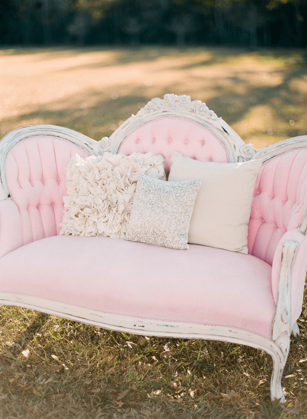 blush pink settee in grass field