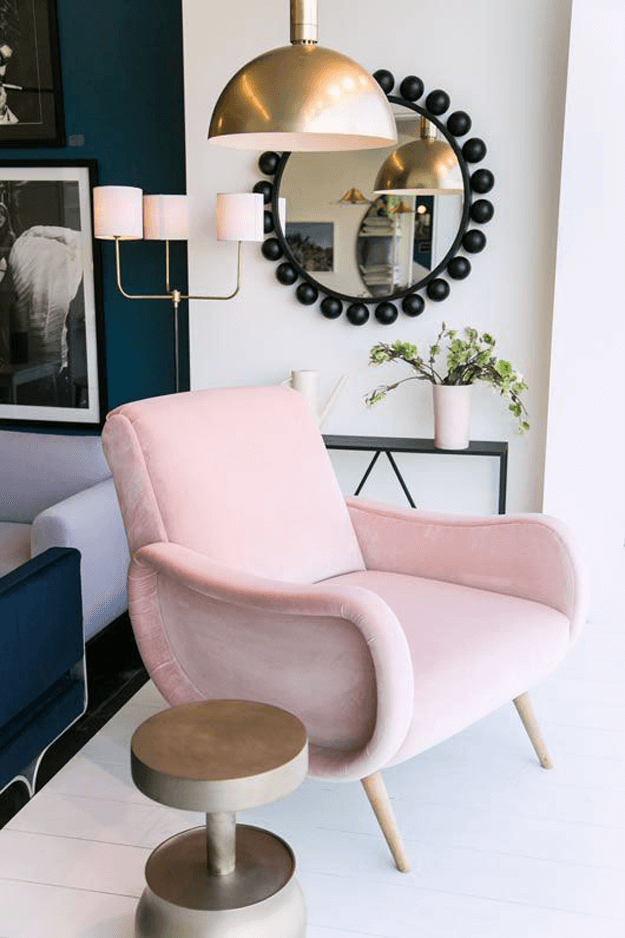 consort design furniture showroom with pink chair