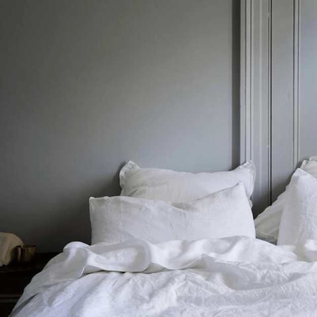 gray bedroom with white linen bedding