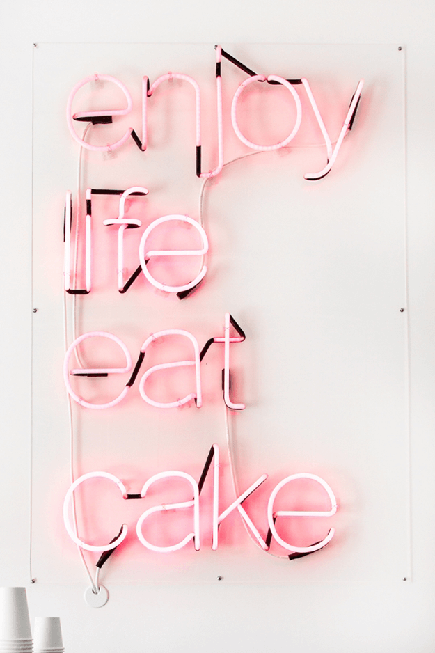 enjoy life eat cake pink neon sign