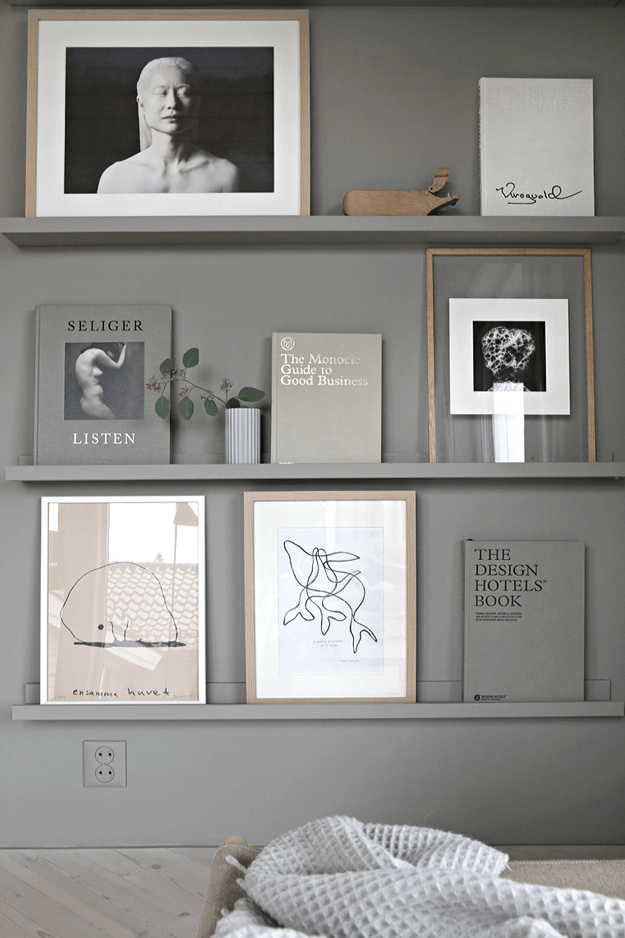 warm grey art and book wall