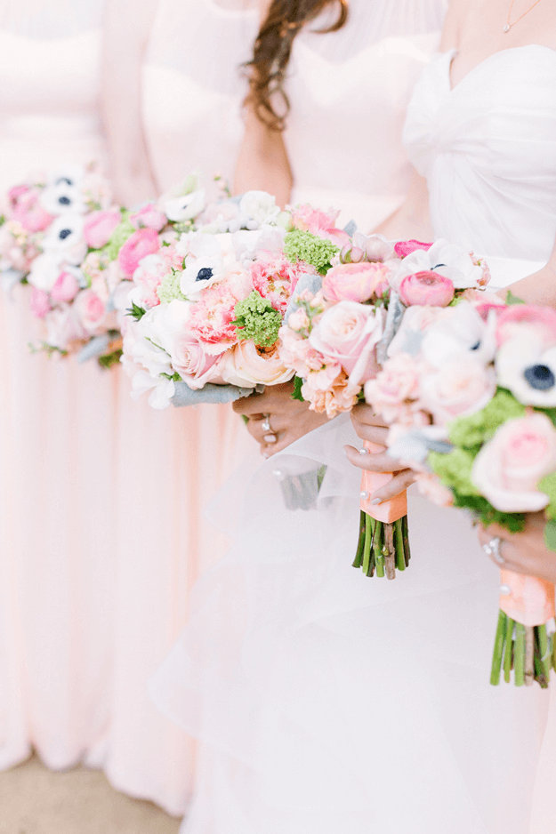 line of bridesmaids with blush pink bouquets