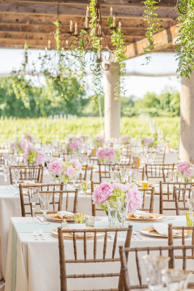 outdoor vineyard wedding with blush pink flowers