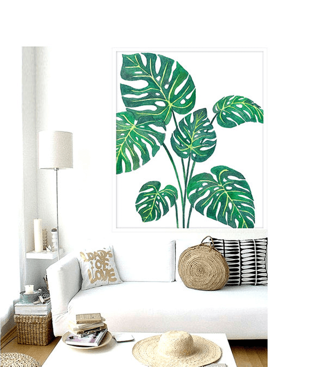 white modern living room with palm leaf poster
