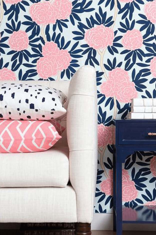 pink floral wallpaper with navy and aqua accents