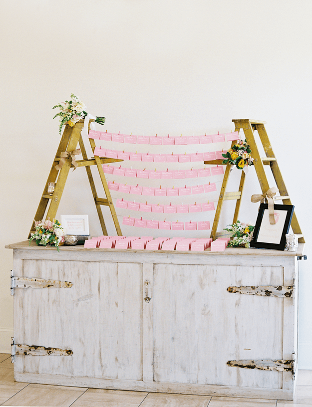 pink place cards on weathered gray console