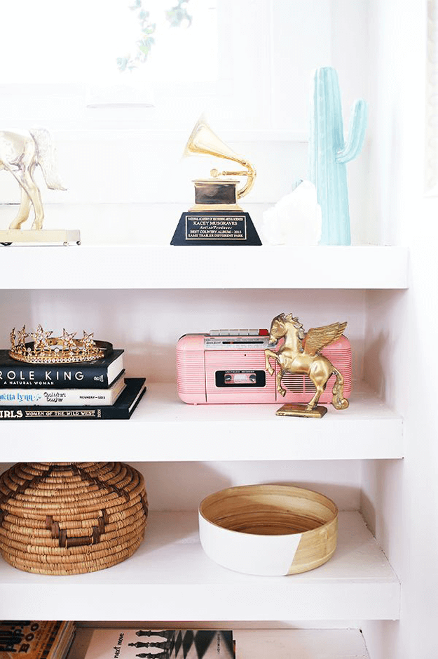 white bookshelf with blush pink accents