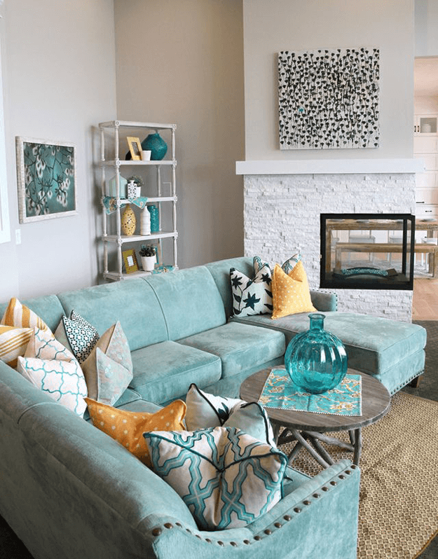 light teal sectional in putty gray room