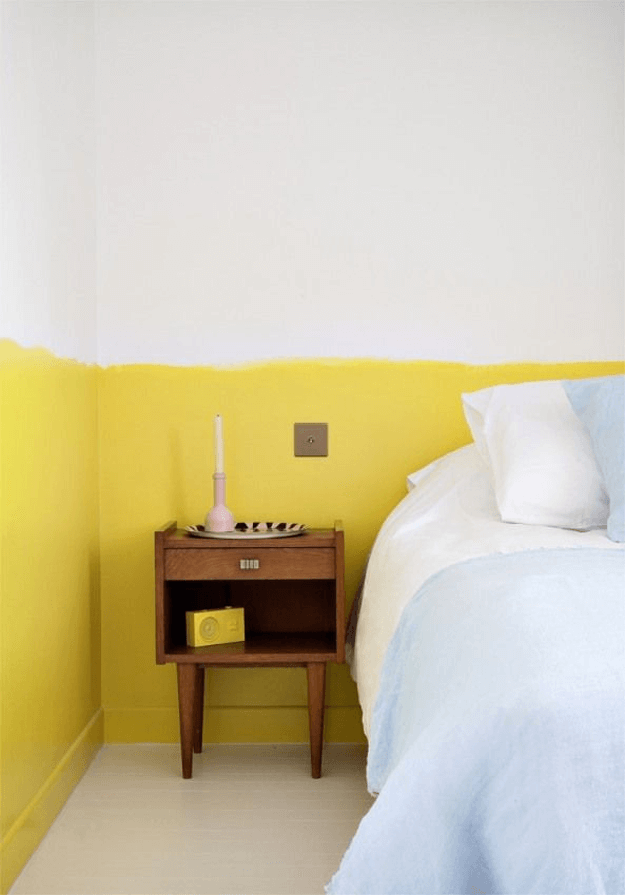 minimalist bedroom with bright yellow wainscot