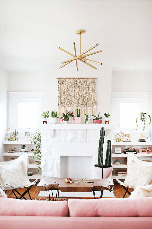 white living room with blush pink and brass accents
