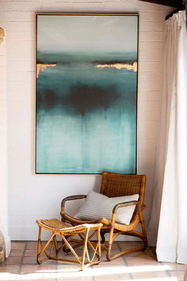 interior with teal and gold abstract wall art