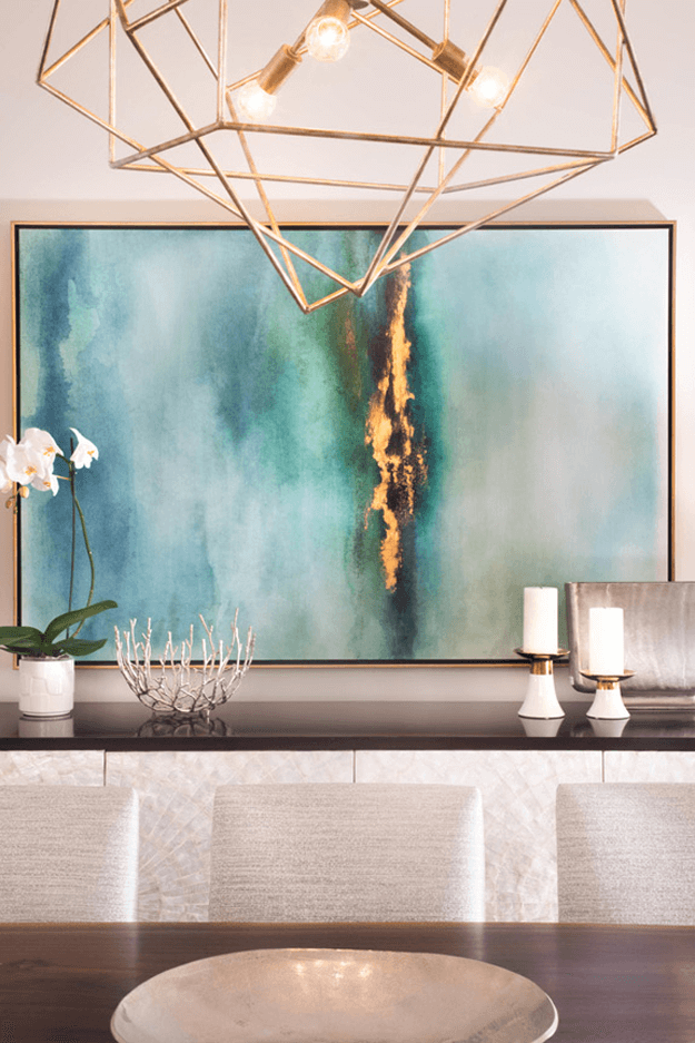 classy interior with teal and gold abstract art