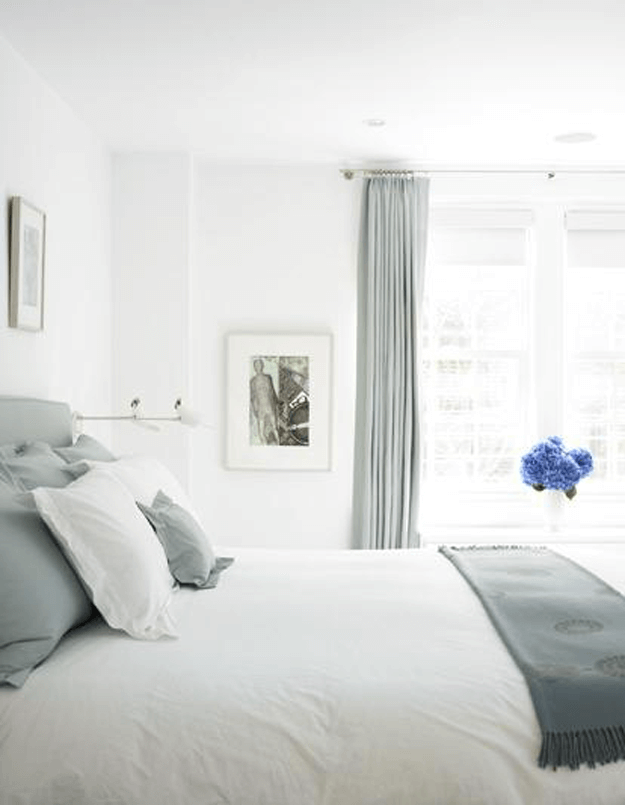 white bedroom with gray accents and blue flowers