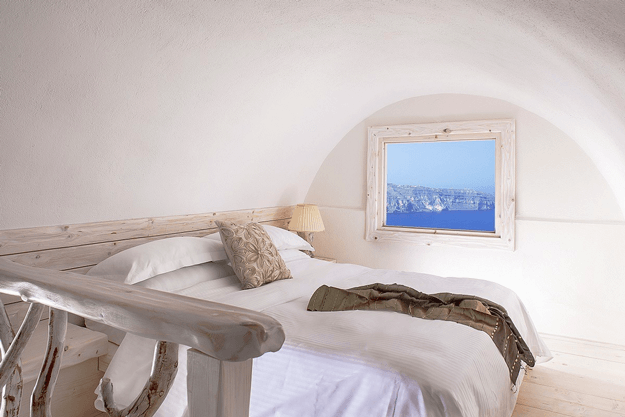 curved ceiling bedroom with bright blue sea view