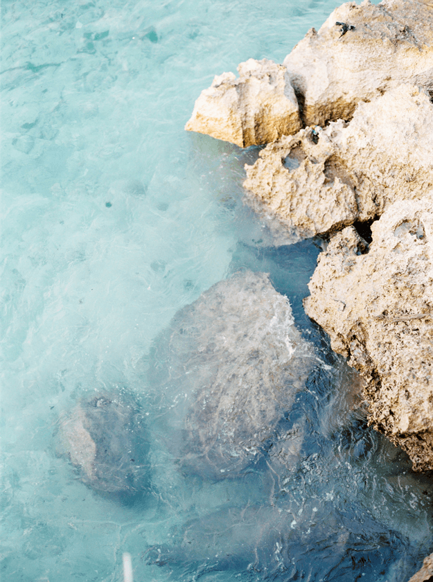 turquoise water with rocky shore
