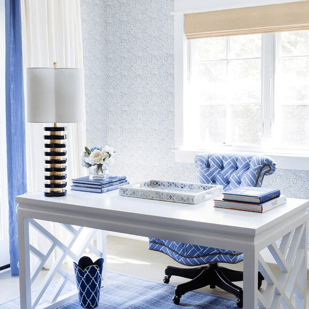 white home office with periwinkle blue accents
