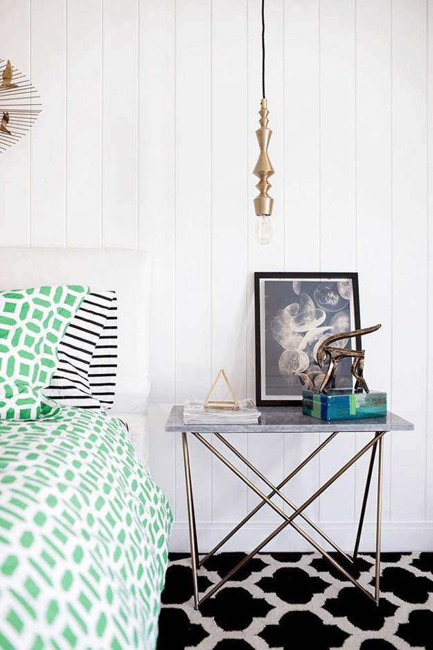 white cottage style bedroom with jade green accents