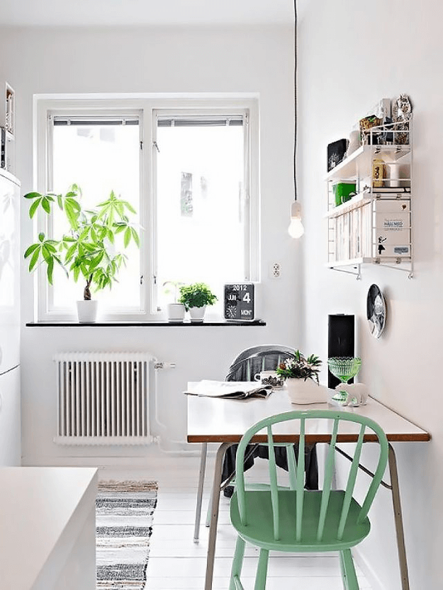 white kitchen with jade green chairs