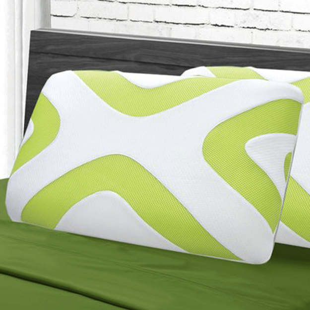 lime green and white patterned pillow