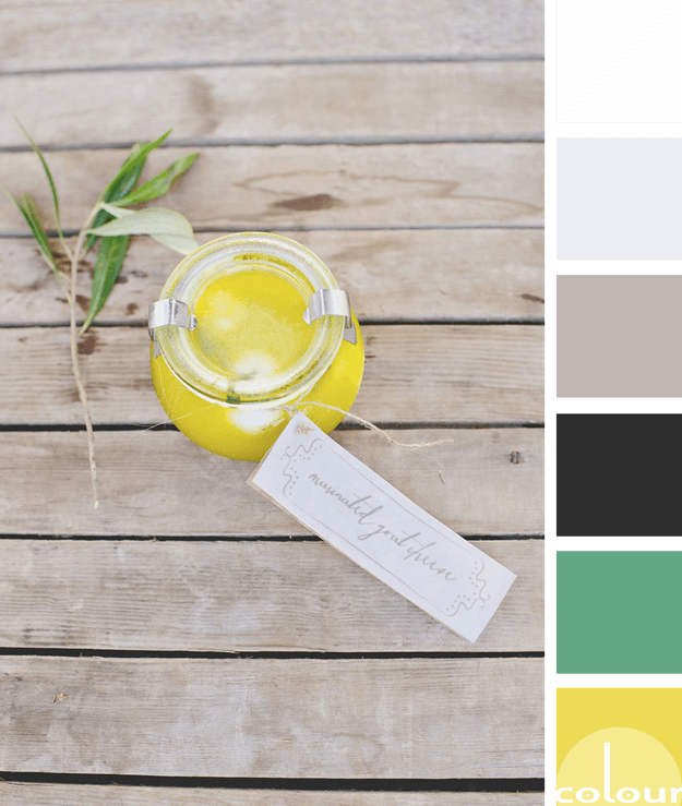 bright yellow party favor on weathered wood