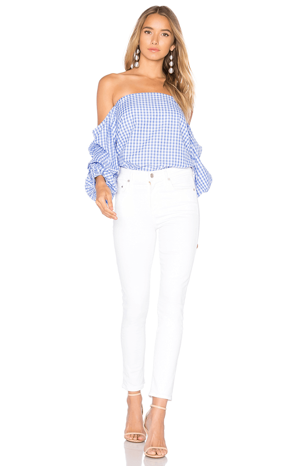 blue gingham shoulder top with white jeans