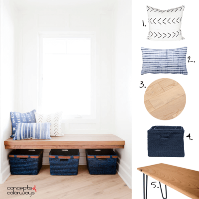 A BENCH SEAT STYLED WITH MUDCLOTH PILLOWS AND INDIGO BASKETS