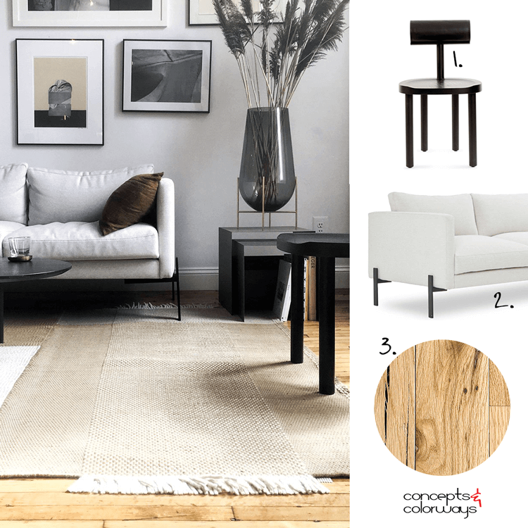 A MASCULINE LIVING ROOM WITH GRAY WALLS AND RUSTIC OAK FLOORING