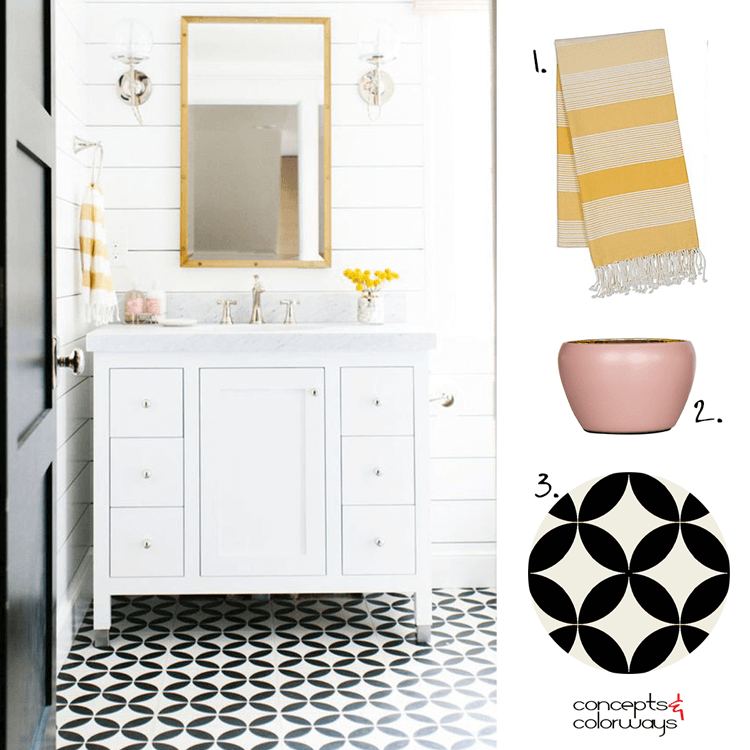 A BLACK AND WHITE BATHROOM WITH PINK AND YELLOW ACCENTS