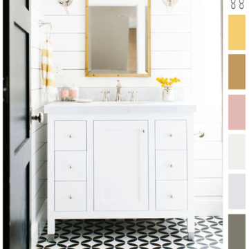 pink and yellow, black and white bathroom, bright yellow, black and white, ochre, blush pink, black and white tile, black door, white marble, white shiplap, yellow flowers, white vanity cabinet, glass globe wall sconce, bamboo mirror, yellow striped towels, towel ring