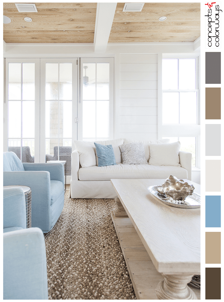 coastal casual, coastal living rooms, coastal color schemes, beach house interior, coastal decor, beach decor, light blue, pale blue, sky blue, tan and blue, white walls, sun bleached wood, metal seashells, textured rug, light blue chair, sky blue chair, casual sofa, white shiplap, warm sand, light tan, light gray, dark bronze, warm brown, light brown, ceiling beams, wood ceiling panels, ivory