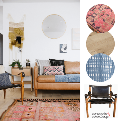 A MODERN BOHO LIVING ROOM WITH VINTAGE RUGS AND A SAFARI CHAIR