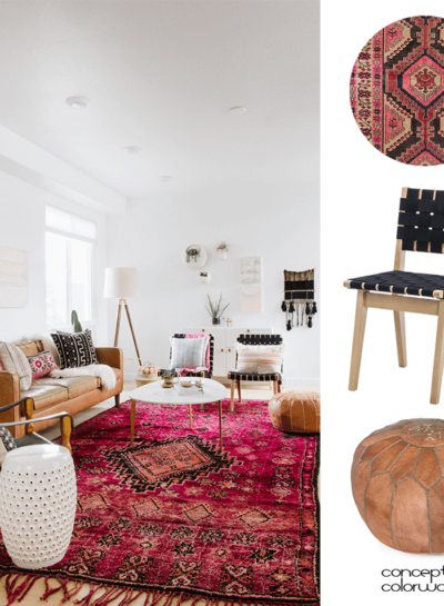 A VINTAGE LIVING ROOM WITH PINK RUG AND TAN LEATHER POUF