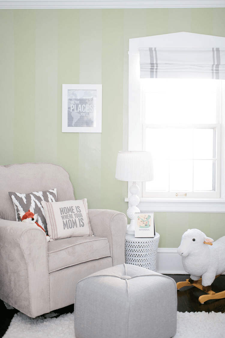sage green paint, sage green color, sage paint color, sage green walls, fox stuffed animal, fox plush, red fox plush, modern nursery, white garden stool, garden stool, ikat fabric, ikat pillows, grain sack fabric, grain sack pillows, white plush rug, white table lamp, dark wood floors, marble painting, striped fabric, modern ottoman, light taupe, burnt orange, warm gray, dove gray, sage green, copper brown, black, black and white, pantone nile green